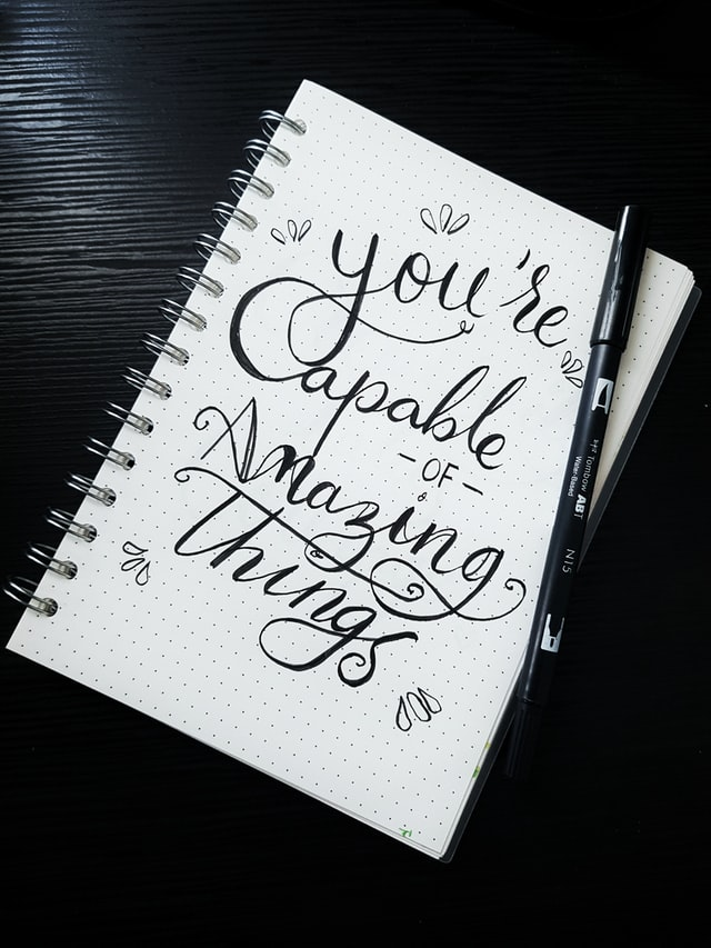 Notebook with confidence affirmations written