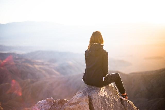 woman on mountain meditating