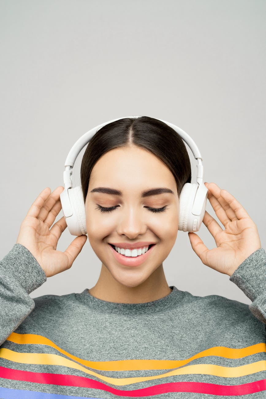 Woman listening to her own written affirmations