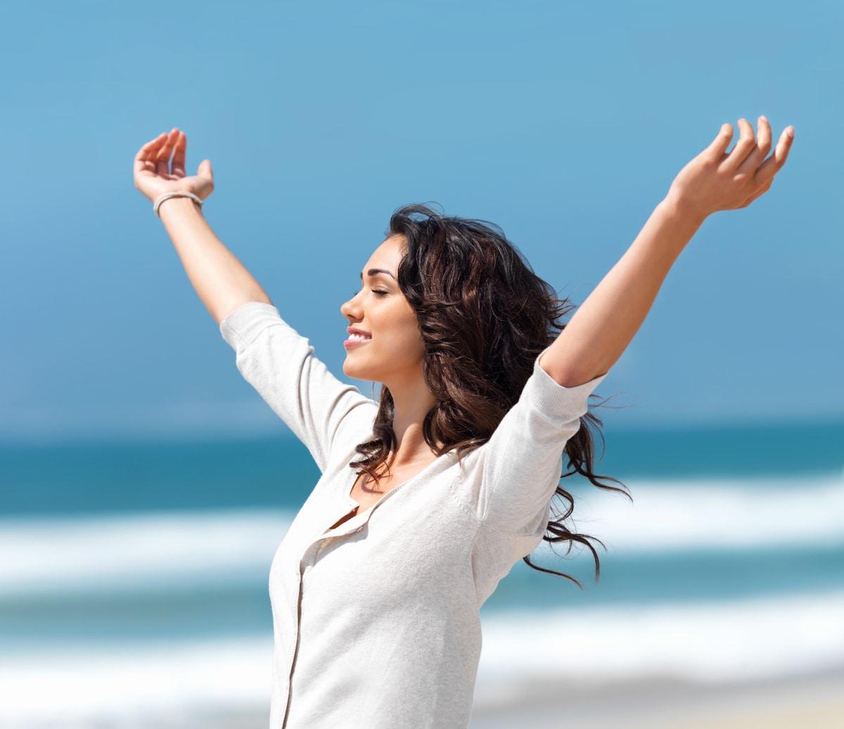 Positive Woman on the beach