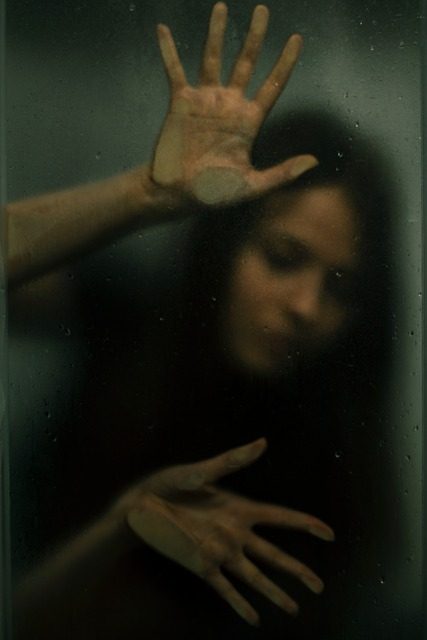 Woman trapped behind glass.