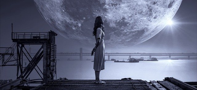Girl dreaming looking at the moon.