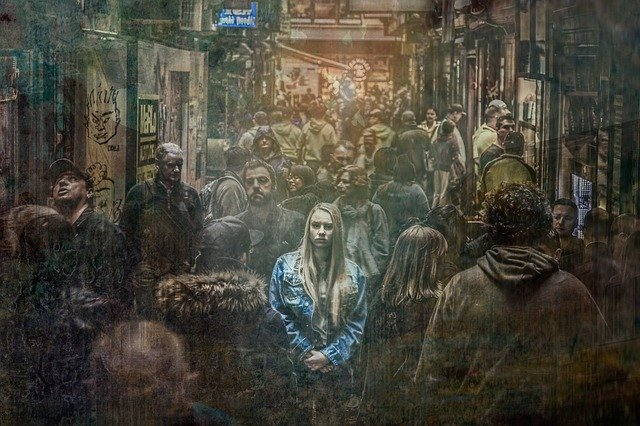 Woman with a fear of open spaces in a crowded street.