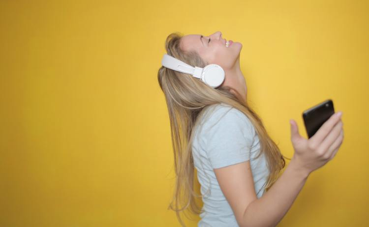 Woman listening to music with  headphones on.