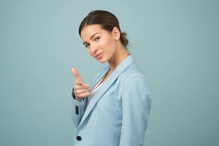 Woman pointing finger at you.