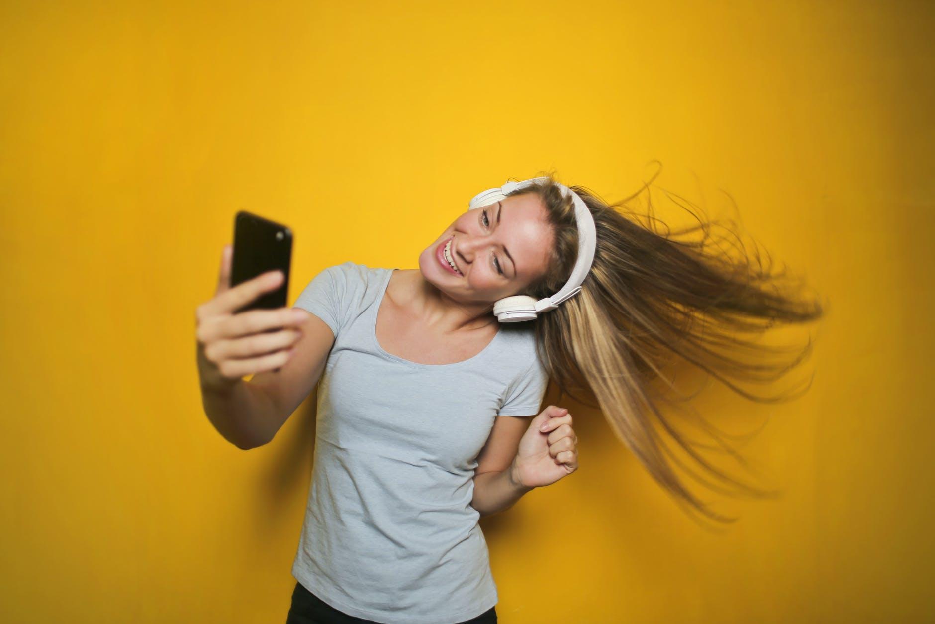 Woman listening to Binaural Beats Music