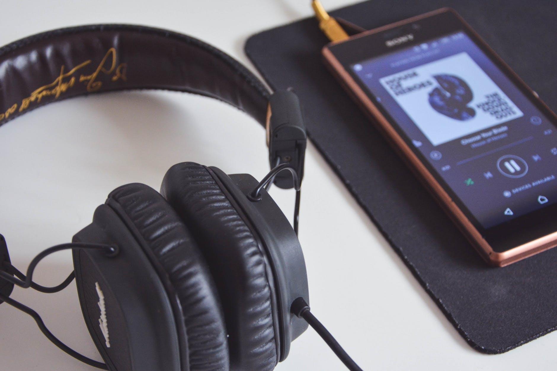 Headphones with smartphone playing Binaural Beats Music