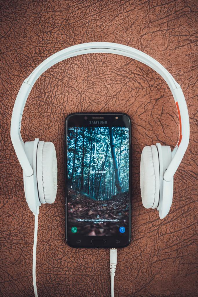 Smartphone with headphones attached.