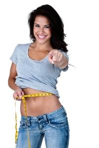 Slim woman with measuring tape around waist.