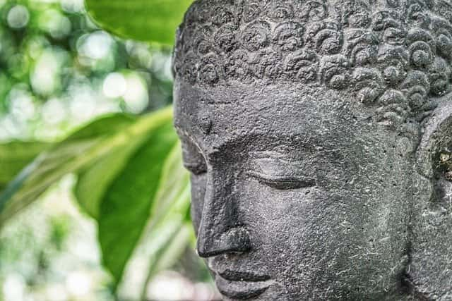 statue of Buddha in garden - crown chakra affirmations