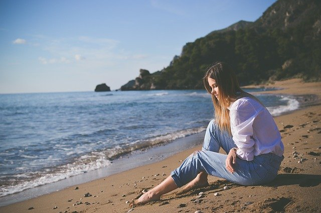 Sad friend sitting on the beach