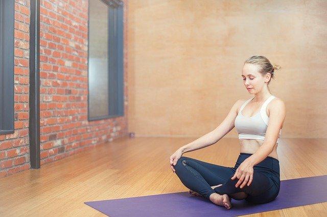 Woman sitting meditating