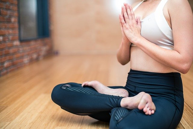 Woman with legs crossed meditating